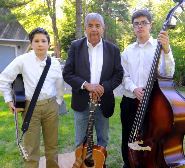 Allen Sockabasin (center)  has been teaching sons Noah Tomah (right), 14, and Zoo-Sap, 11, Passamaquoddy from an early age.