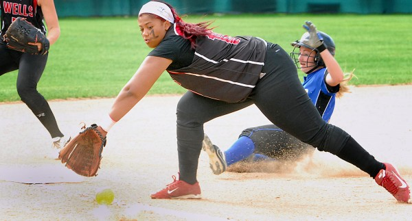 Wells High School's Jordan Agger (18) can't pick a throw out of the dirt in time to tag out Hermon's Allessa Oakes (10) at third base during the Class B state softball final at Coffin Field Brewer.