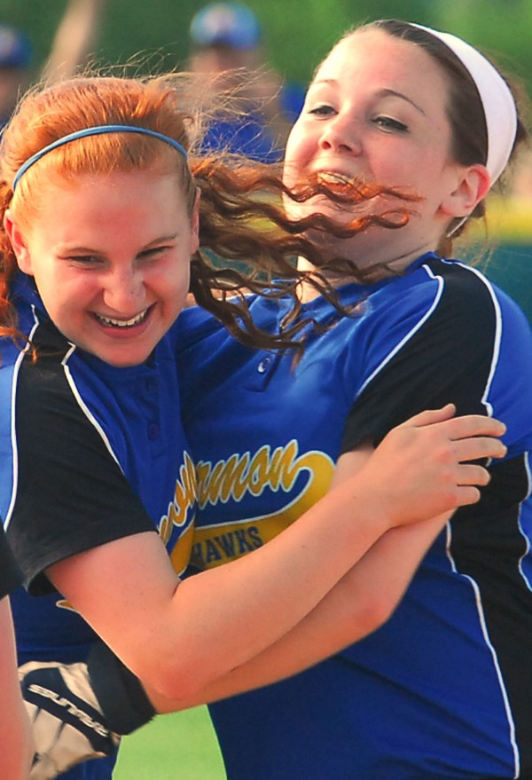 Hermon High School's Claire Petersen(left) and Deanna Phipps celebrate after defeating Wells for the Class B Championship at Coffin Field in Brewer Saturday.