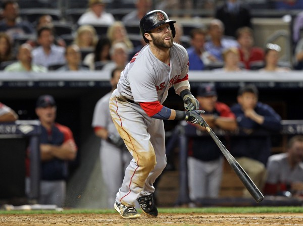 Boston's Dustin Pedroia (15) hits an RBI single against the New York Yankees during the fifth inning at Yankee Stadium Sunday night.