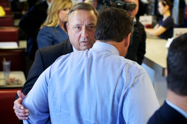 Maine Gov. Paul LePage talks with New Jersey Gov. Chris Christie on May 7 at Becky's Diner in Portland.