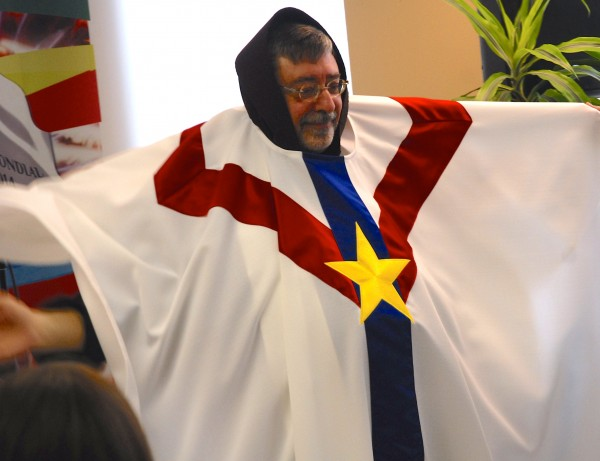 Rev. Jacques LaPointe models the Acadian-themed vestments he hopes every priest and bishop will wear when saying Mass during the World Acadian Congress. &quotI'm in competition with Captain America,&quot the priest joked during a recent press conference.
