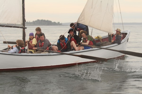 Students row their 30-foot open sailboat, also known as a pulling boat, off the coast of Port Clyde, Maine on June 14, 2014. During the course, the small boat is their classroom and home.