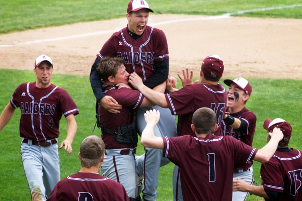 The Washington Academy Raiders celebrate on the field at St. Joseph's College in Standish after defeating Sacopee Valley High School for the State Class C Baseball Championship on Saturday.
