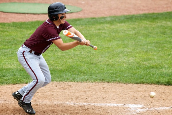 Washington Academy's Cameron Varney bunts at the plate on Saturday in Standish as his team defeats Sacopee Valley High School for the State Class C Baseball Championship on Saturday.