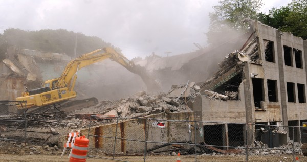 The demolition of the former Bangor Police Department building continues Tuesday.