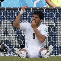 Suarez faces another ban after biting Italian defender