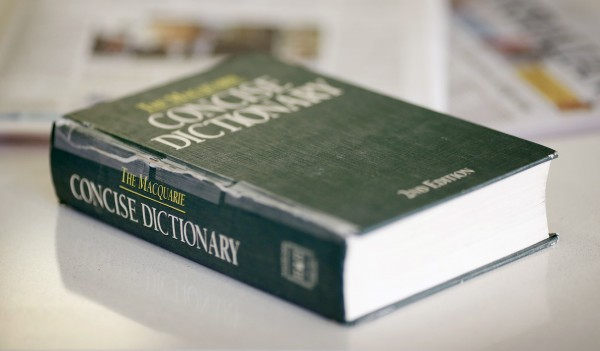 A photo illustration shows a 2nd edition copy of The Macquarie Concise Dictionary on a coffee table in Sydney in this October 2012 file photo.