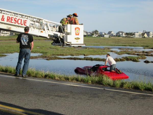 A Corvette sits in a Wells marsh after it crashed Saturday.