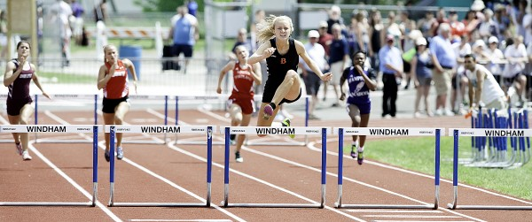 Brewer's Synclaire Tasker clears her hurdle way ahead of her opponents for an easy 45.47-second first-place win in the Class A State girls' 300 meter hurdles in Windham.