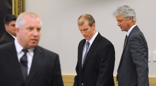 Nicholas Sexton (center) with his attorneys Jeffrey Toothaker (left) and David Bate at the Penobscot Judicial Center Wednesday, May 28.
