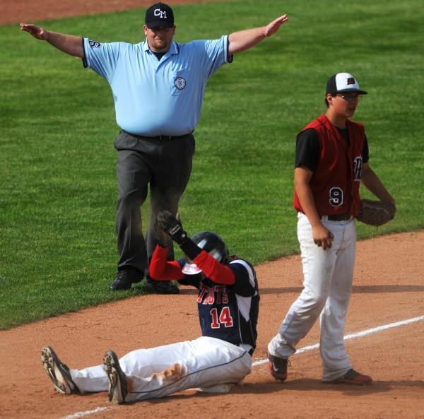 Bangor Christian's Tucker Rice (left) claps after safely sliding into third past Wiscasset's Tyler Bailey during their Class D baseball state championship game at Mansfield Stadium Saturday in Bangor. Bangor Christian won 5-4 in eight innings.