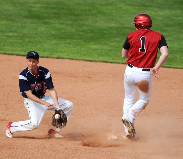 Wiscassett's Matthew Craig (right) makes it safely to second before Bangor Christian's Dean Grass can make the catch during their Class D baseball state championship game at Mansfield Stadium Saturday in Bangor. Bangor Christian won 5-4 in eight innings.