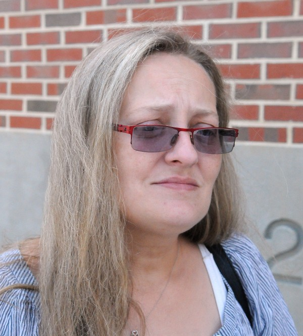Vicki Lynn Whitmore of Caribou stands outside the Penobscot Judicial Center in Bangor on Monday. Whitmore's son Adam Morin, 25, was stabbed Thursday night on Warren Street in Bangor.