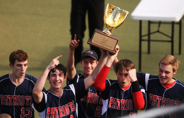 Bangor Christian's (from left) Seth Pearson, Cody Collins, Zac Palmeter, Tucker Rice, and Kyle Holmes raise their championship trophy after defeating Wiscassett on Saturday during their Class D baseball state championship game at Mansfield Stadium in Bangor.