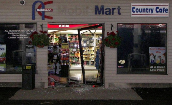 A police photo of the storefront damage made during the break-in at the A.E. Robinson store in Corinth on June 22, 2012.