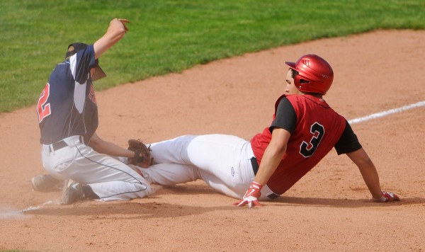 Bangor Christian's Zac Palmeter (left) tags Wiscasset's Chandler Longfellow out at third during their Class D baseball state championship game at Mansfield Stadium Saturday in Bangor. Bangor Christian won 5-4 in eight innings.