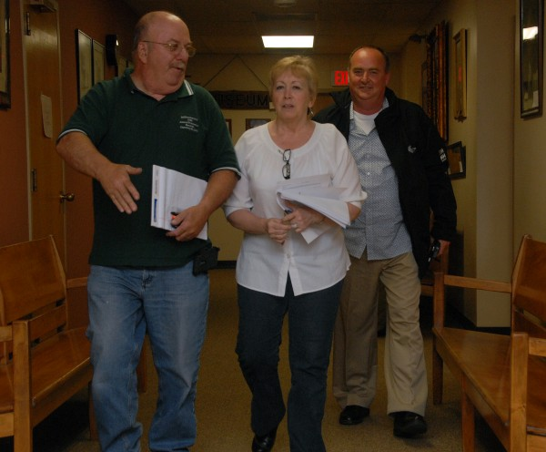 [Left to right] Millinocket Town Council Chairman Richard Angotti Jr., Town Manager Peggy Daigle and Cate Street Capital President and CEO John Halle emerged looking amicable following an executive session at the Millinocket town office on Friday, June 6, 2014.