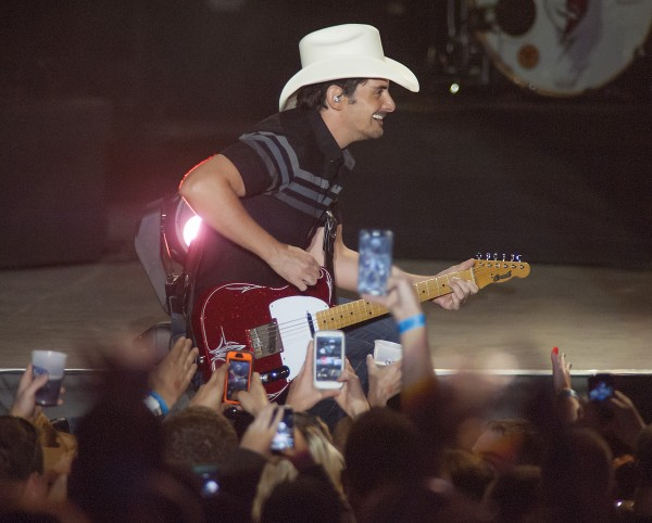 Fans cheer and take pictures as country singer Brad Paisley performs at the Darling's Waterfront Pavilion in Bangor on Sunday night.