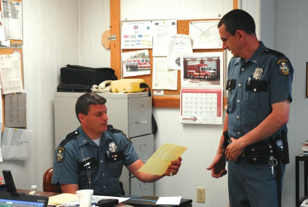 t. Christopher Coleman (left) of the Maine State Police Major Crimes Division goes over details of the ongoing manhunt for Jesse Marquis with Maine State Police Lt. John Cote at the incident command post in St. Francis on Monday.