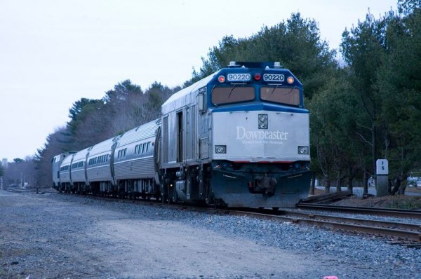 An Amtrak Downeaster train idles near the proposed location of the train layover facility between Church Road and Stanwood Street in Brunswick.