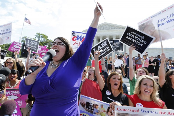 Kristan Hawkins of Students for Life leads anti-abortion demonstrators as they cheer after the ruling for Hobby Lobby was announced outside the U.S. Supreme Court in Washington June 30, 2014. The U.S. Supreme Court on Monday ruled that business owners can object on religious grounds to a provision of President Barack Obama's healthcare law that requires closely held companies to provide health insurance that covers birth control.