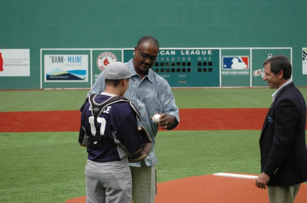 Little League catcher Daniel Gaunce, 13, from Waterville receives the autographed ball that Boston Red Sox legend and Hall of Famer Jim Rice pitched at the dedication ceremony for the newly renovated Harold Alfond Fenway Park Saturday in Oakland, Maine.