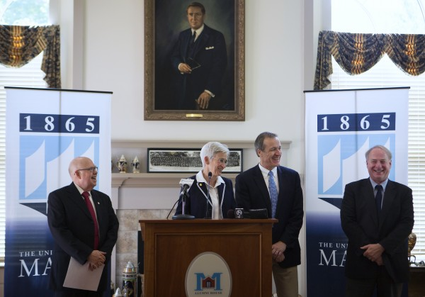 Susan Hunter (second from left), the newly appointed University of Maine president, speaks with press Tuesday at the Buchanan Alumni House in Orono.