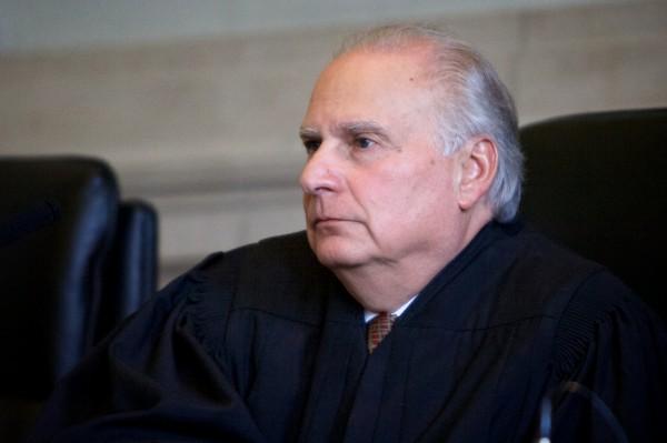 Justice Warren M. Silver