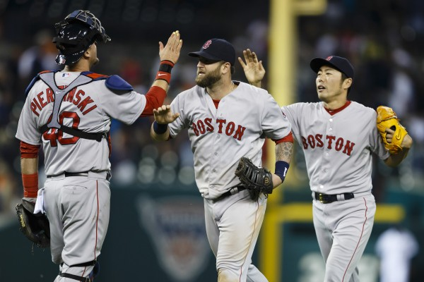 Boston Red Sox catcher A.J. Pierzynski (40) and first baseman Mike Napoli (center) and relief pitcher Koji Uehara (right) celebrate after the game against the Detroit Tigers at Comerica Park in Detroit Sunday night. Boston won 5-3.