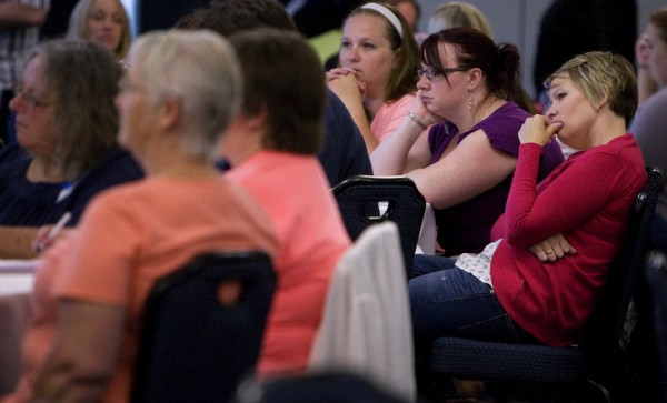 Abbie Rohde (right) listens to keynote speaker Teresa Ostler addresses the audience on the topic of &quotAssessing Parenting Risk in Individuals with Major Mental Illness.&quot