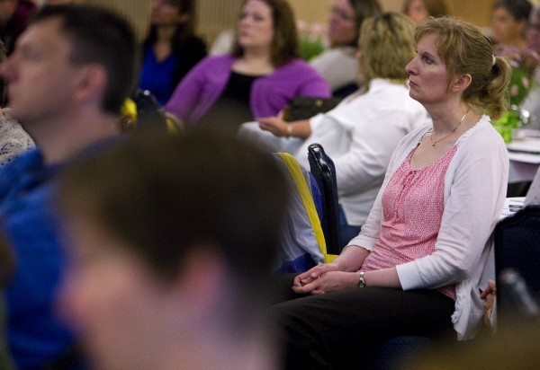 Lori Haydem (right) listens to keynote speaker Teresa Ostler addresses the audience on the topic of &quotAssessing Parenting Risk in Individuals with Major Mental Illness.&quot