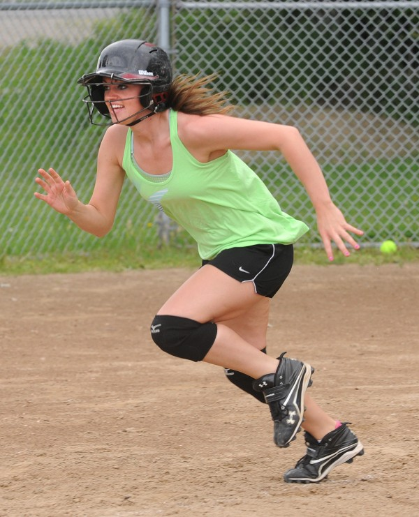 Nokomis High School's right fielder Taylor Shaw runs to first base during softball practice in Newport on Monday.