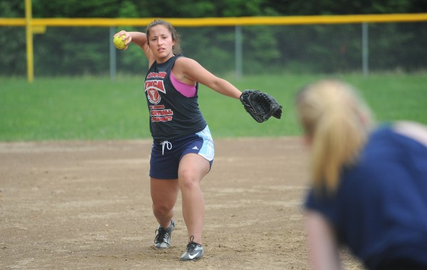 Nokomis High School third baseman Mikayla Charters throws the ball during softball practice in Newport on Monday.