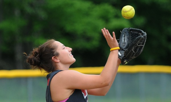 Nokomis High School third baseman Mikayla Charters catches the ball during softball practice in Newport on Monday.