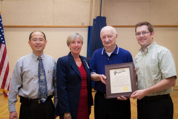 Former Bangor coach and teacher Bob Kelley (second from right) holds a proclamation from the Bangor City Council after the gymnasium at the James F. Doughty Middle School was named in honor of Kelley during a ceremony at the Doughty School in Bangor. With Kelley are (from left)Dr. Jay Ye, vice chairman of the school committee; Dr. Betsy Webb, superintendent of schools; and city council chairman Ben Sprague.