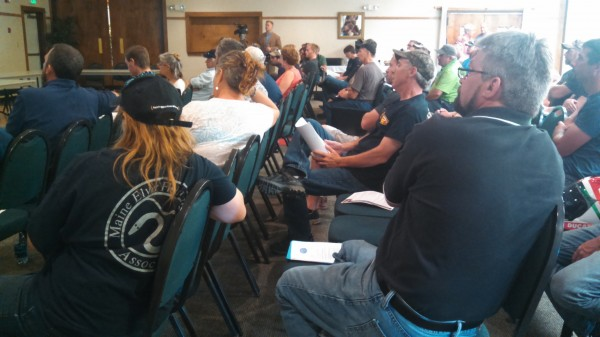 Maine elver fishers listen to a presentation on Maine's elver fishery on Monday in Brewer.