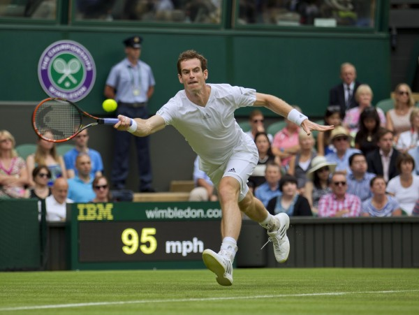 Andy Murray in action during his match against David Goffin on day one of the 2014 Wimbledon Championships on Monday at the All England Lawn and Tennis Club.