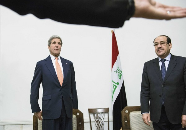 U.S. Secretary of State John Kerry (left) meets with Iraqi Prime Minister Nuri al-Maliki at the latter's office on Monday in Baghdad.