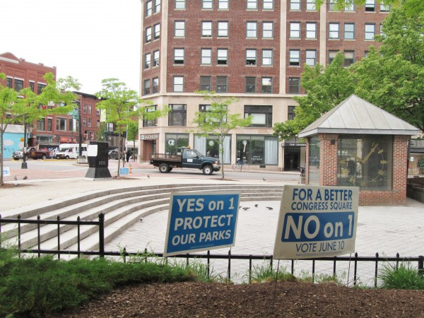 Campaign signs surround Congress Square on Tuesday, as Portland residents take to the polls to decide the fate of the public space.