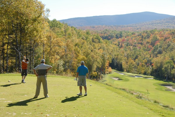Golfers enjoy some fall foliage as they play the 10th hole at Sugarloaf Golf Club in September 2013. The BDN is asking readers to submit their choices for Maine's toughest golf holes.