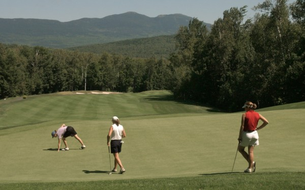 Abby Spector (right) was among the women playing the 17th green at Sugarloaf Golf Club during the 2002 Women's Maine State Golf Association Championship.