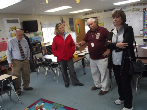 U.S. Rep Chellie Pingree (second from left) of Maine and U.S. Rep. Betty McCollum (right) of Minnesota listen to Michael Chadwick (second from right), principal of the Beatrice Rafferty School on the Passamaquoddy Reservation, during a tour of the school with Ron Jenkins (left), superintendent of Maine Indian Education.