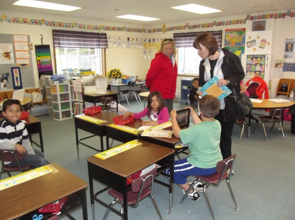 U.S. Rep. Chellie Pingree of Maine (left) and U.S. Rep. Betty McCollum of Minnesota visit a class as they tour the Beatrice Rafferty School on the Passamaquoddy Reservation. The legislators want to secure federal funds to replace the aging school.