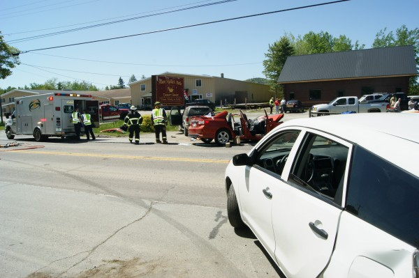 Officials investigate a three-car accident on Route 1A in Holden Saturday morning.