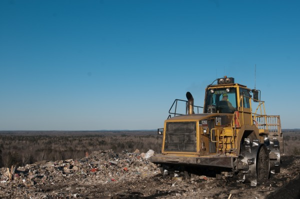 A worker flattens trash at the Juniper Ridge Landfill in Old Town in January 2013.