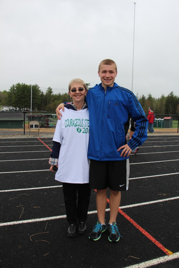 Connor Archer stands with Lynn Faerber, the director of the Green House Nursery School in Milford, during the fundraising event he organized on May 18, Courageous Steps, at the Victory Field complex on the Old Town High School campus.