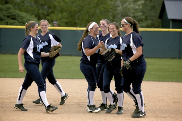 Calais players cheer for Kaylee Johnson (2nd from left) after she dove for a ball, made the catch and ended the top of the sixth inning during their Eastern Maine Class C softball final against Bucksport Tuesday evening at Coffin Field in Brewer.