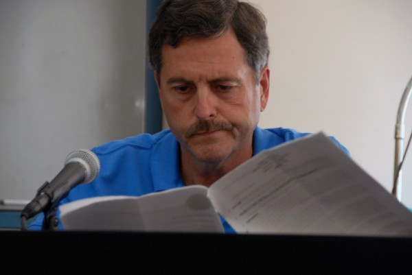 Millinocket Town Councilor Jimmy Busque reads documents during a council meeting Monday.
