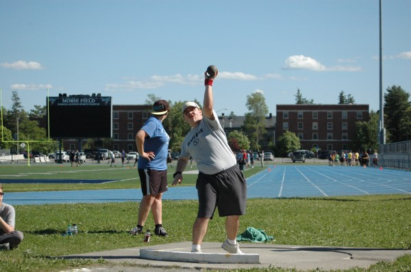 Vermont native Nick Phalen tries his hand at shot put at the University of Maine Alfond Sports Stadium Thursday during the New England Blind Athletic Association Summer Sports Camp.